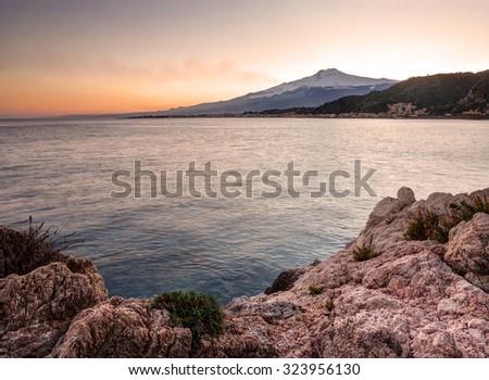 Sicily, Italy: Mount Etna seen from Taormina at sunset - stock photo