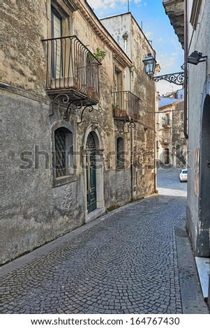 Sicily, Italy - SEPTEMBER 12, 2013: Empty alley in the old little town in Sicily, Italy. To walk into this place is to walk back in time into the medieval era.  - stock photo