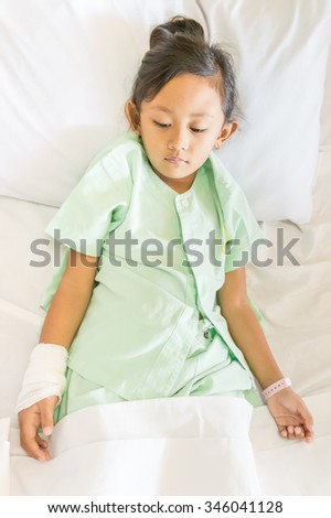 Sick Asian Little Girl Happy Inpatient in Hospital - stock photo