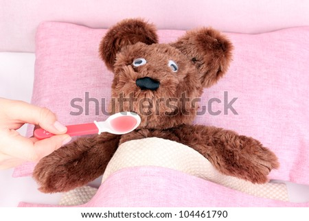 Sick bear in bed - stock photo
