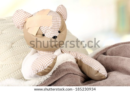 Sick bear in bed close-up - stock photo