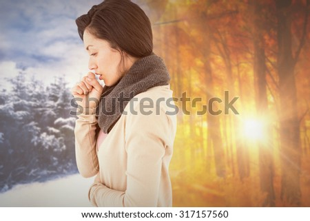 Sick brunette coughing against autumn changing to winter - stock photo