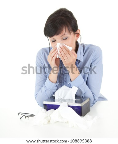 sick businesswoman with flu blowing nose in tissue, white background - stock photo