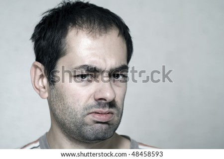 Sick caucasian young un-shaved man - stock photo