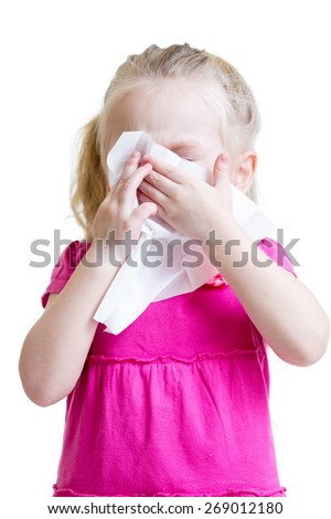 sick child wiping or cleaning nose with tissue isolated on white - stock photo