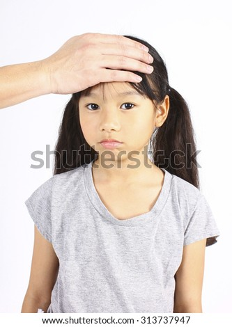 Sick child with hand on forehead