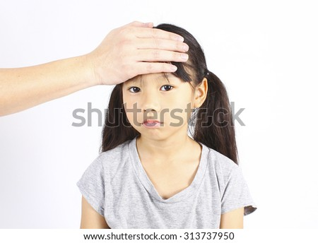 Sick child with hand on forehead - stock photo