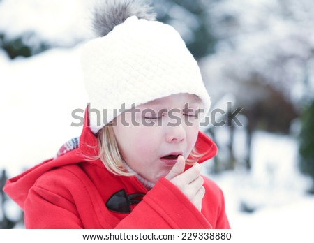 Sick girl coughing with flu in a snowy winter - stock photo