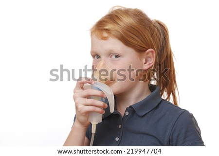 Sick girl inhales some medicine on white background - stock photo