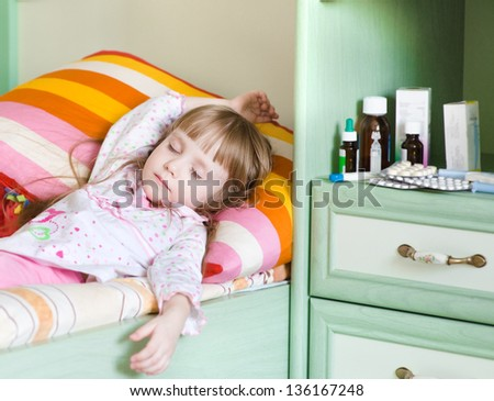 sick girl lying on a bed - stock photo