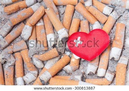 Sick heart on cigarette bulls. Stop smoking now