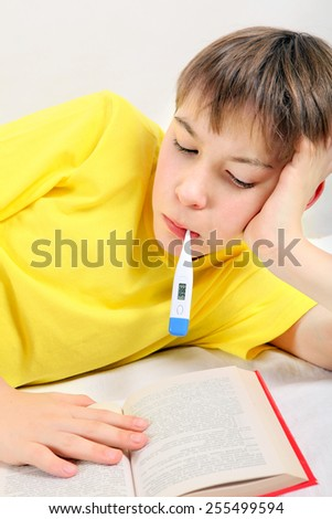 Sick Kid with a Book and Thermometer on the Bed - stock photo