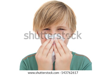 Sick little boy with a handkerchief on white background