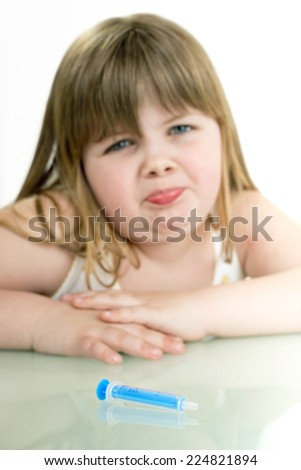 sick little girl is afraid of injections/sick little girl - stock photo