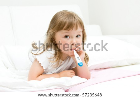 sick little girl  on bed - stock photo