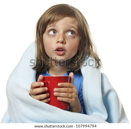 sick little girl with a cup of hot tea - white background - stock photo