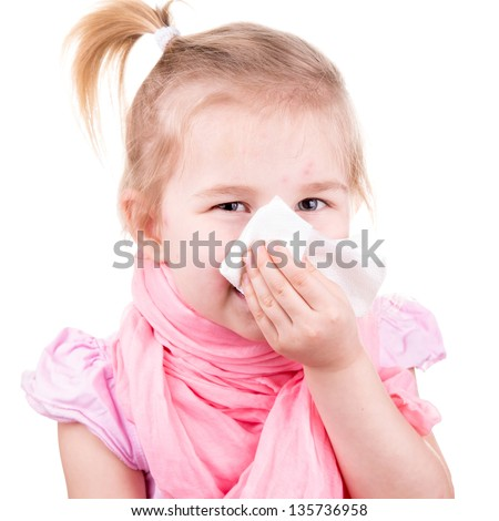 Sick little girl with chickenpox with napkin sneezing isolated on white
