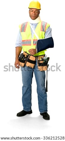 Sick Male Construction Worker with short black hair in uniform using neck brace and having arm in a sling - Isolated - stock photo