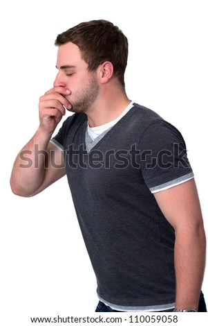 Sick man coughing into he's hand - stock photo