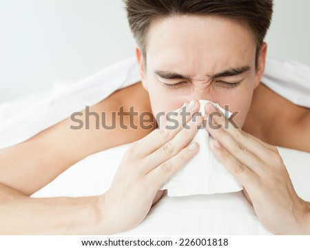 Sick men. Flu. Men caught cold. Sneezing into tissue. Virus - stock photo