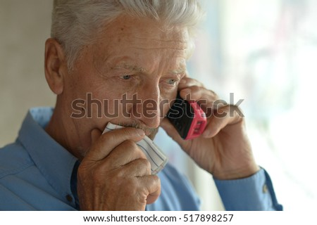 Sick old man calling doctor