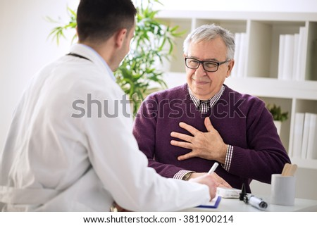 Sick old man visit doctor specialist about pains in breasts - stock photo