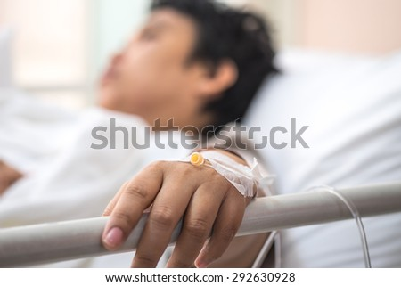 Sick patient lying on bed in hospital for medical background - stock photo