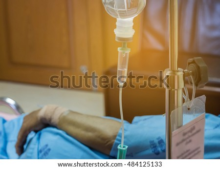 Sick patient lying on bed in hospital for medical  blur background