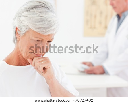 Sick patient with her doctor - stock photo