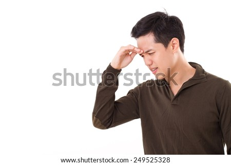 sick, stressed man suffers from headache pain - stock photo