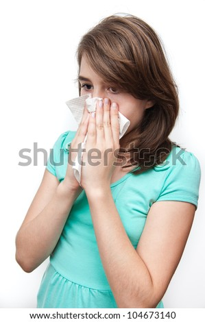 Sick teen girl using tissue. All on white background. - stock photo