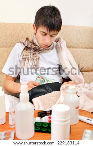 Sick Teenager checking the Wallet on the Sofa at the Home - stock photo