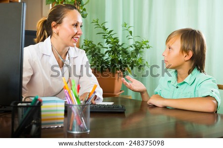 Sick teenager patient complaining to doctor about symptoms of malaise - stock photo