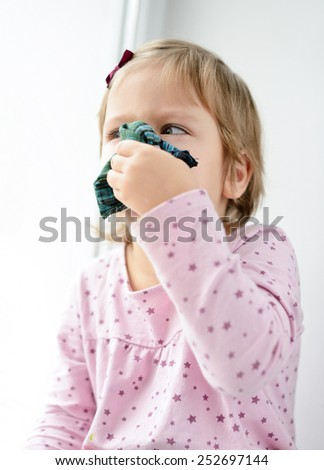 sick toddler girl with handkerchief at the home - stock photo