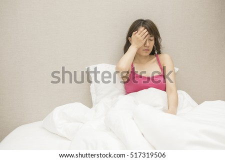Sick woman on the bed at home