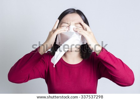 Sick Woman Sneezing in to Tissue Paper - stock photo