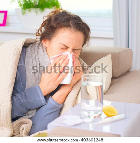 Sick Woman Sneezing into Tissue. Allergy reaction. Flu.Woman Caught Cold. Headache. Virus. Flue - stock photo