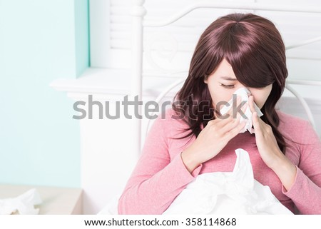 Sick Woman sneezing into Tissue. Flu and Woman Caught Cold. - stock photo