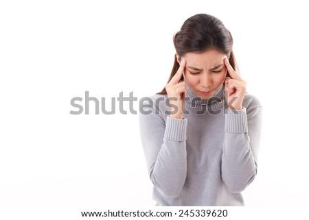 sick woman with acute headache, winter clothing studio shot - stock photo
