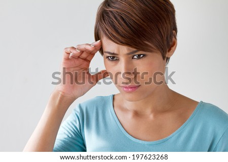 sick woman with pain, headache, migraine, stress, insomnia, hangover in casual dress, hand holding head, quarter view - stock photo