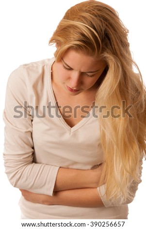 Sick woman with pain in the stomach or belly isolated over white background.