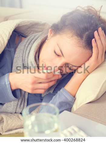 Sick Woman with Thermometer. Allergy reaction. Flu.Woman Caught Cold. Sneezing into Tissue. Headache.Virus.Flue - stock photo