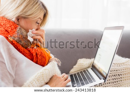 Sick woman working from home - stock photo