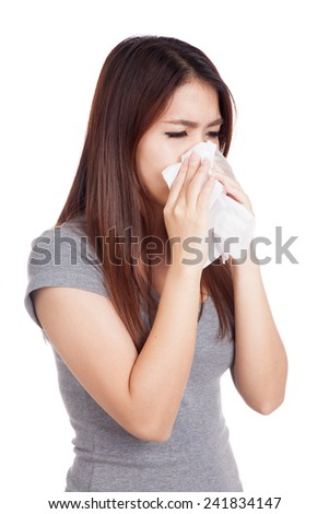 Sick Young Asian woman  using a tissue paper  isolated on white background
