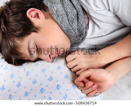 Sick Young Man sleep on the Bed