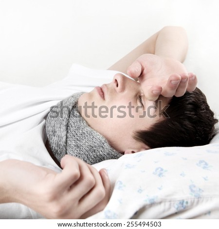 Sick Young Man sleep on the Bed at the Home