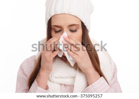 Sick young woman in pajamas scarf and hat coughing and blowing. Woman sick blowing nose isolated. Sick Woman. Flu. Woman Caught Cold