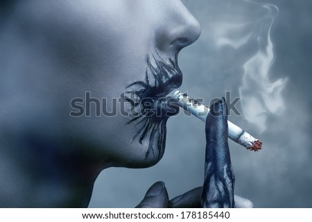 Sick young woman smokes a cigarette, side view, concept of harm smoking - stock photo