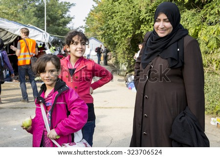 SID, SERBIA - OCTOBER 3, 2015: Refugees prepare themselves to cross the Serbo-Croatian border between the cities of Sid (Serbia) and Bapska (Croatia).