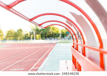 Side bench at an empty soccer stadium - stock photo